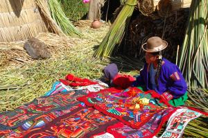 Young Uros girl selling her crafts