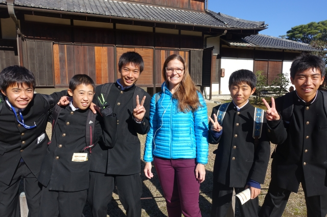 cute school kids wanting picture with americans