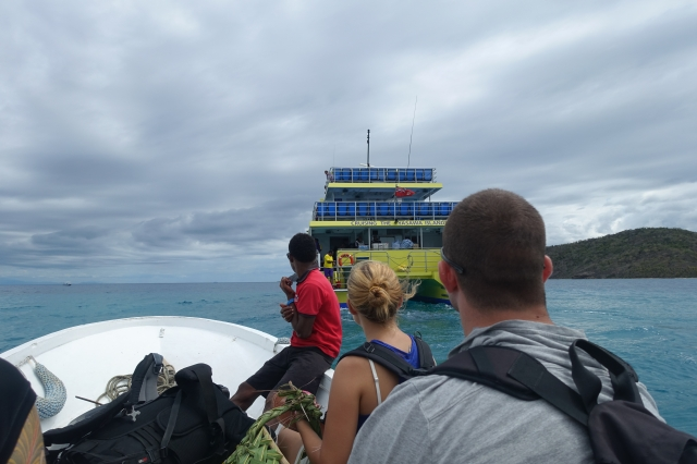 On the little boat, getting on the big boat to the mainland