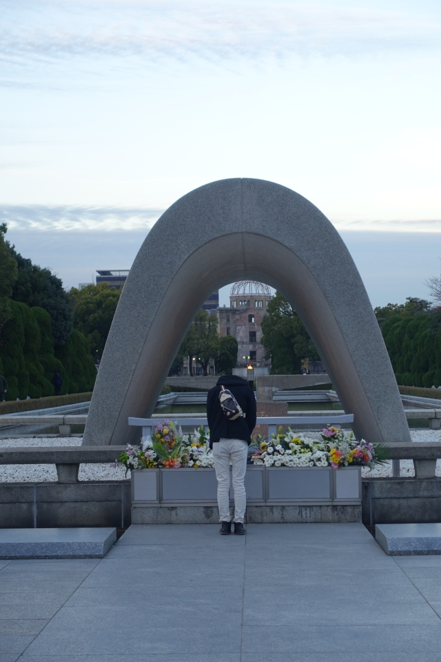 man bowing at cenotaph