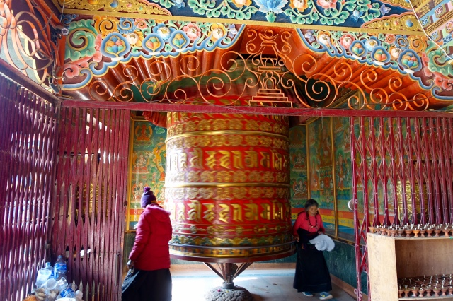 praying by boudhanath stupa
