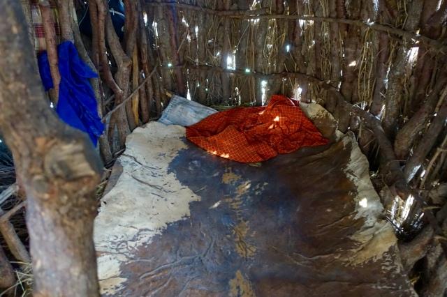 bed inside hut