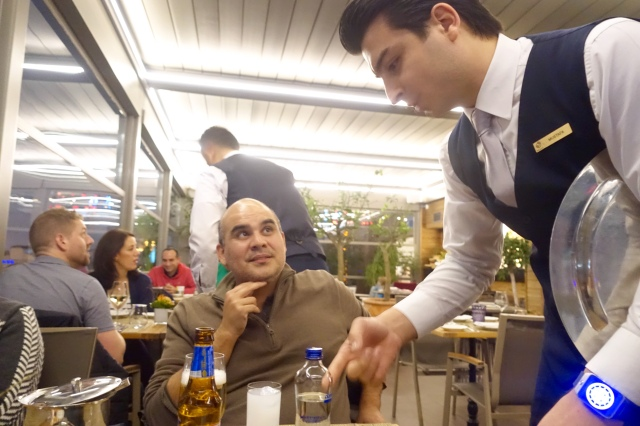 "mustafa ""moosty"", our favorite waiter, explaining how to drink raki, the national liquor"